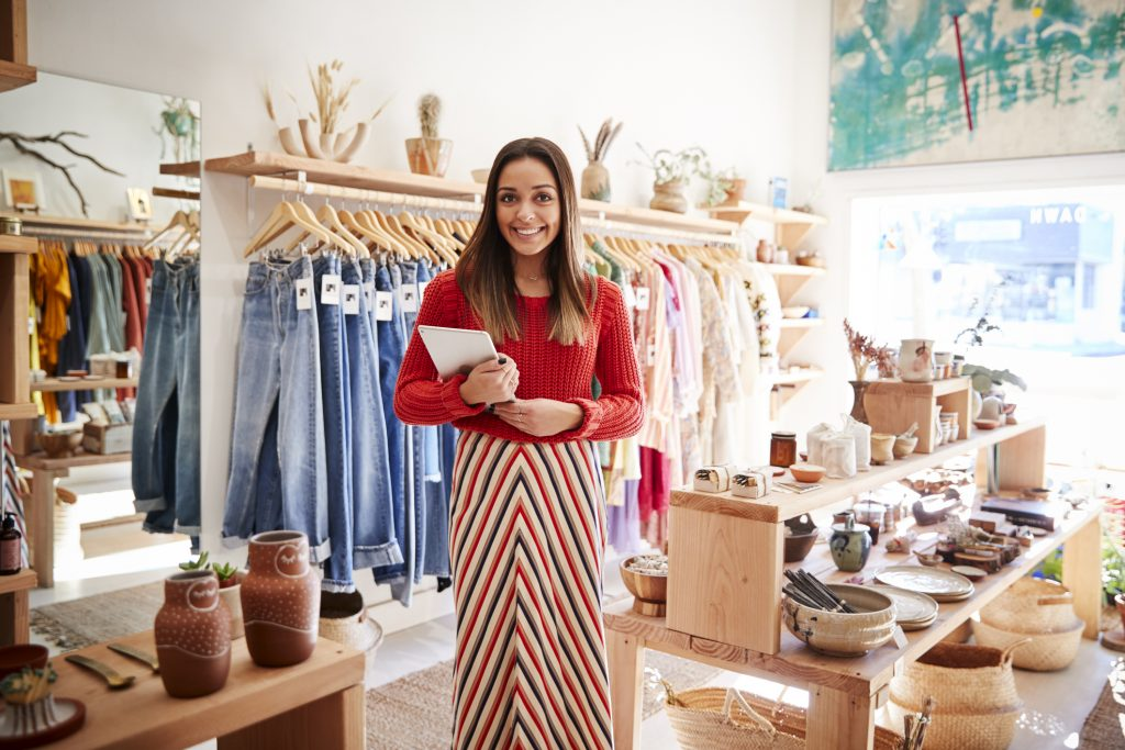 Store owner in clothing shop